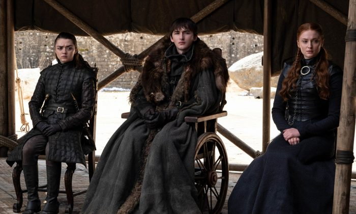 "This image released by HBO shows from left to right Maisie Williams, Isaac Hempstead Wright and Sophie Turner in a scene from the final episode of ""Game of Thrones,"" that aired on May 19, 2019. (HBO via AP)"