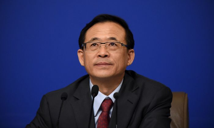 Former Chairman of China Securities Regulator Surrenders to Anti-Corruption Investigation