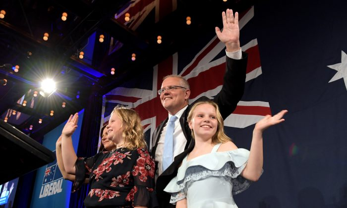 Prime Minister of Australia and leader of the Liberal Party Scott Morrison, flanked by his wife Jenny Morrison and daughters Lily Morrison and Abbey Morrison, delivers his victory speech at the Sofitel Sydney Wentworth in Sydney, Australia on May 18, 2019.