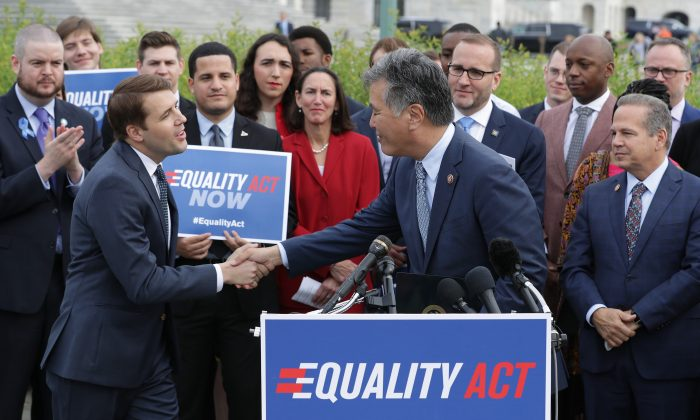 Rep. Mark Takano (D-CA) (C) welcomes Rep. Chris Pappas (D-NH) to the lectern during a rally and news conference with Rep. David Cicilline (D-RI) (R) and leaders from LGBTQ advocacy organizations before the House votes on the Equality Act May 17, 2019 in Washington, DC.   Chip Somodevilla/Getty Images