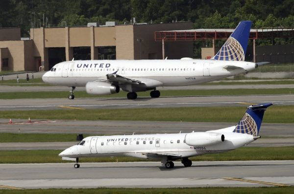 United Airlines and United Express planes prepare to take off