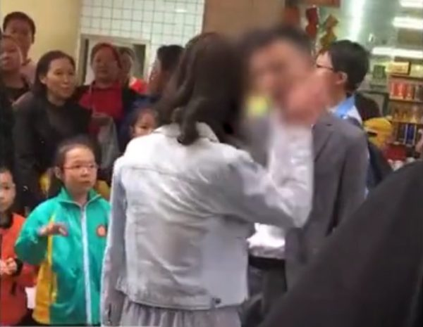 Woman slap crowd