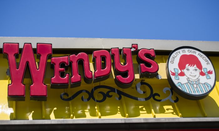 In this file image, a Wendy's sign is seen outside their restaurant in Bowie, Maryland on May 9, 2017. (Jim Watson/AFP/Getty Images)