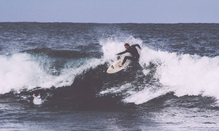 Life can overwhelm you like a set of giant waves. Your best option is to stand up and ride one. (Alec Bennett/Unsplash)