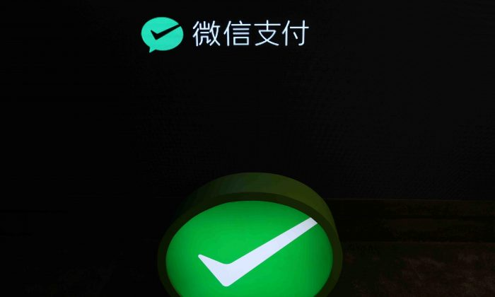 A Wechat Pay sign is pictured at a Wechat Pay pop-up store in Shanghai, China on Jan. 20, 2018. (Reuters)