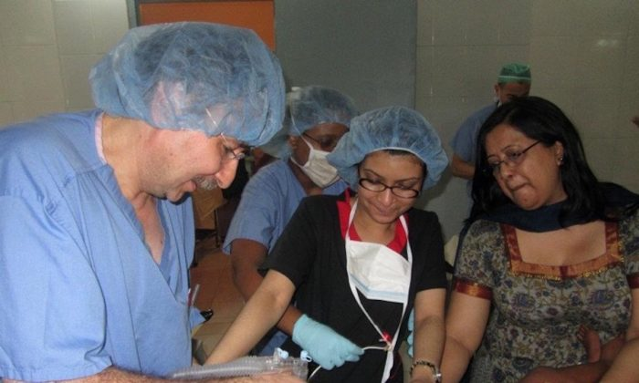 Dr. Shenjuti Chowdhury (C) assisting during surgery. (Courtesy of Dr. Shenjuti Chowdhury)