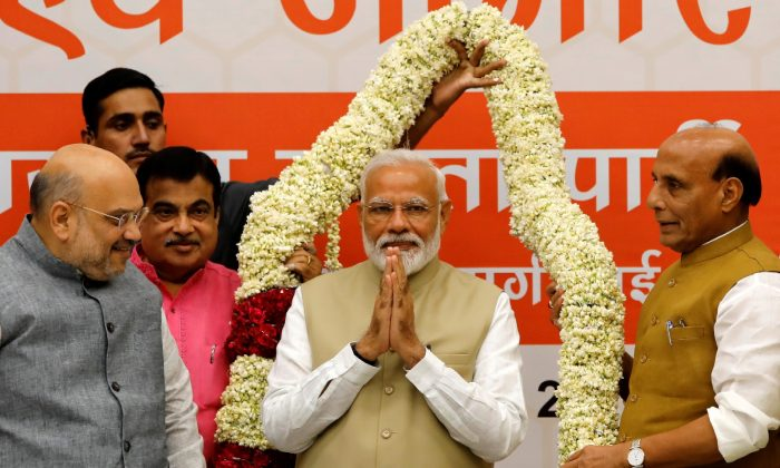 India's Prime Minister Narendra Modi gestures as he is presented with a garland during a thanksgiving ceremony by Bharatiya Janata Party (BJP) leaders to its allies at the party headquarters in New Delhi, India on May 21, 2019. (Anushree Fadnavis/File Photo/Reuters)