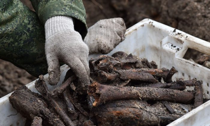Belarus' servicemen excavate a mass grave for the prisoners of a Jewish ghetto set up by the Nazis during World War Two, that was uncovered at a construction site in the city of Brest, on Feb. 27, 2019. (Sergei Gapon/AFP/Getty Images)