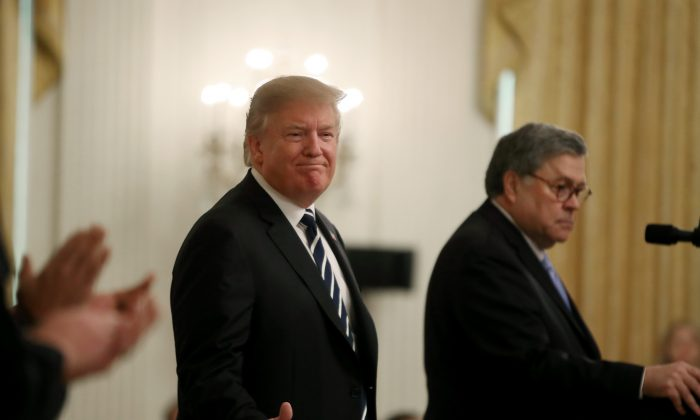 President Donald Trump (L) stands with Attorney General William Barr before the presentation of the Public Safety Officer Medals of Valor in the East Room of the White House on May 22, 2019. (Mark Wilson/Getty Images)