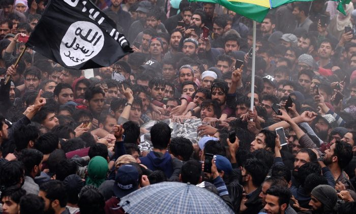 People carry the body of Zakir Rashid Bhat also known as Zakir Musa, the leader of an al Qaeda affiliated terrorist group in Kashmir, during his funeral procession in Dadasara village in south Kashmir's Tral on May 24, 2019. (Danish Ismail/Reuters)