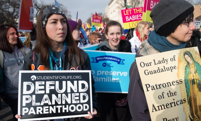"""Anti-abortion activists participate in the """"March for Life,"""" an annual event to mark the anniversary of the 1973 Supreme Court case Roe v. Wade, which legalized abortion in the US, outside the US Supreme Court in Washington, DC, January 18, 2019. (Saul Loeb/AFP/Getty Images)"""