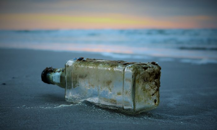 This composed file image shows a bottle with a message. (Pixabay)