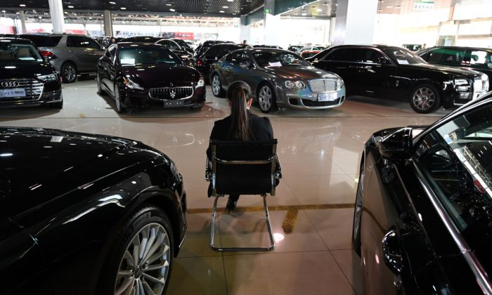 A woman at a car dealership in China. (Greg Baker/AFP/Getty Images)