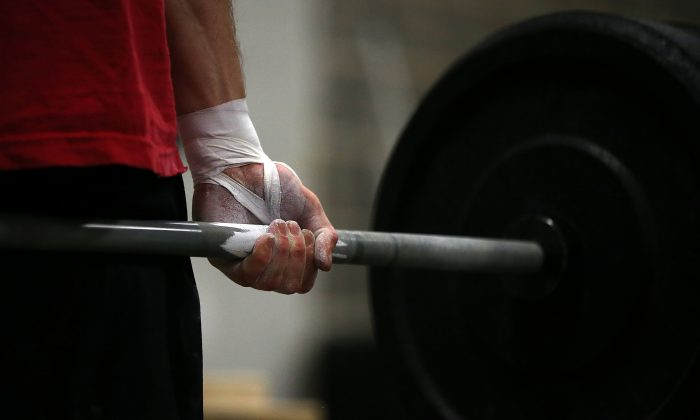 A man doing CrossFit workout at Ross Valley CrossFit in San Anselmo, Calif., on March 13, 2014. (Justin Sullivan/Getty Images)