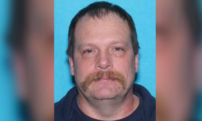 Michael John Wolfe, 52, was arrested on May 24, 2019, one day after he was named a person of interest in the case of missing mother Karissa Fretwell and her son William Fretwell. (Salem Police Department)