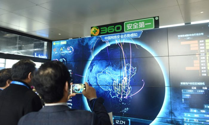 A man taking pictures of internet security data displayed on a screen at the Qihoo booth during the 4th World Internet Conference in Wuzhen, Zhejiang Province, China. (AFP/Getty Images)
