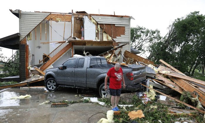 Joe Armison looks over damage to his home after a tornado struck the outskirts of Eudora, Kan., on May 28, 2019. (Colin E. Braley/AP