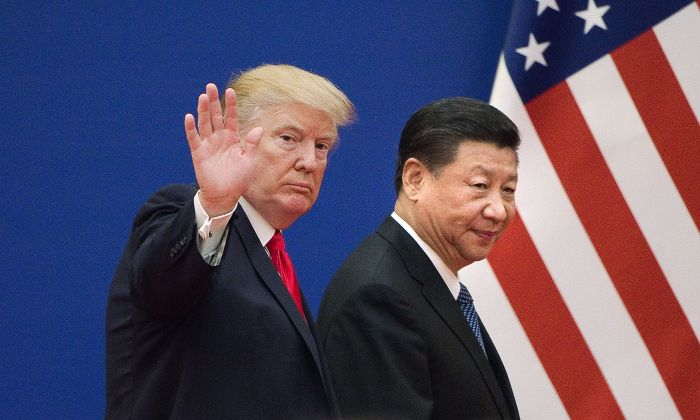 U.S. President Donald Trump (L) and Chinese leader Xi Jinping leave a business leaders event at the Great Hall of the People in Beijing on November 9, 2017. (NICOLAS ASFOURI/AFP/Getty Images)