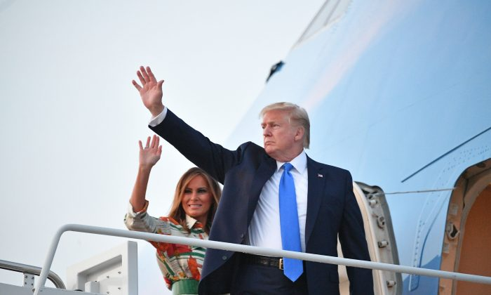 President Donald Trump and First Lady Melania Trump make their way to board Air Force One before departing from Andrews Air Force Base in Maryland on June 2, 2019. - US President Donald Trump is flying to England for a three-day state visit.       (Mandel Ngan/AFP/Getty Images)