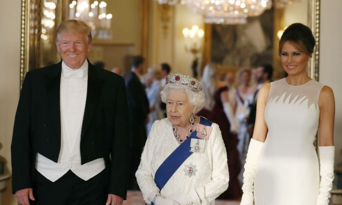 Queen Elizabeth II (C),U.S. President Donald Trump (L) and First Lady Melania Trump (R) attend a State Banquet at Buckingham Palace on June 3, 2019 in London, England. President Trump's three-day state visit will include lunch with the Queen, and a State Banquet at Buckingham Palace, as well as business meetings with the Prime Minister and the Duke of York, before travelling to Portsmouth to mark the 75th anniversary of the D-Day landings. (Jeff Gilbert - WPA Pool/Getty Images)