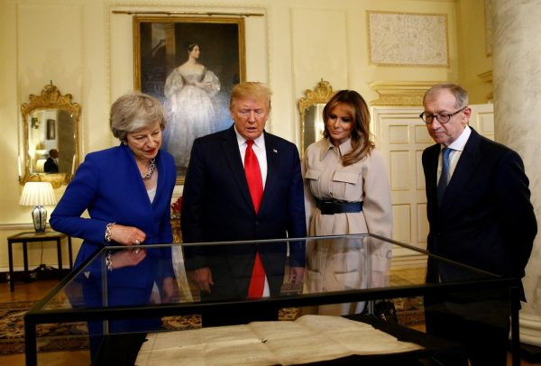 President Donald Trump and First Lady Melania Trump review items with Britain's Prime Minister Theresa May and her husband Philip