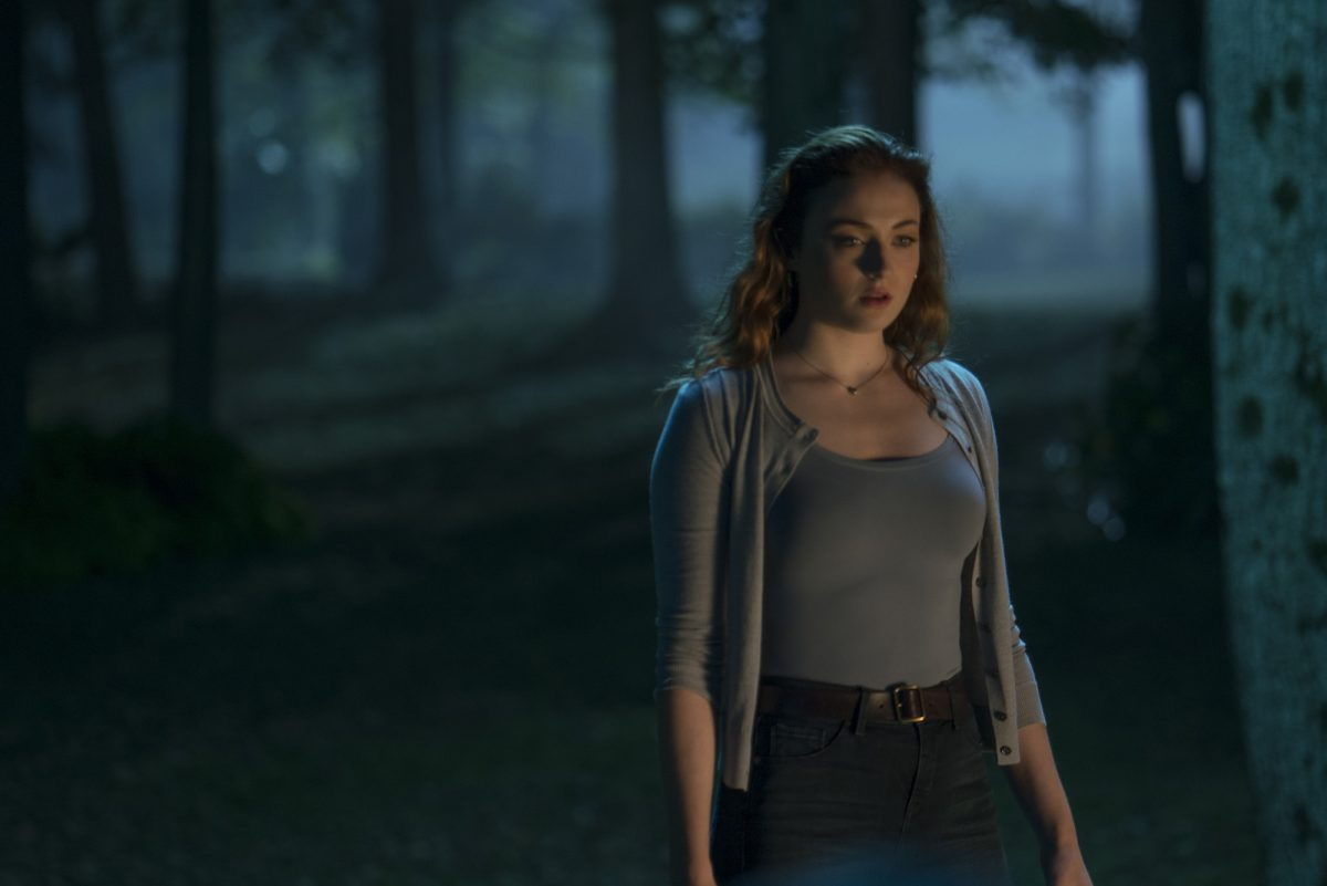 woman in grey sweater in woods