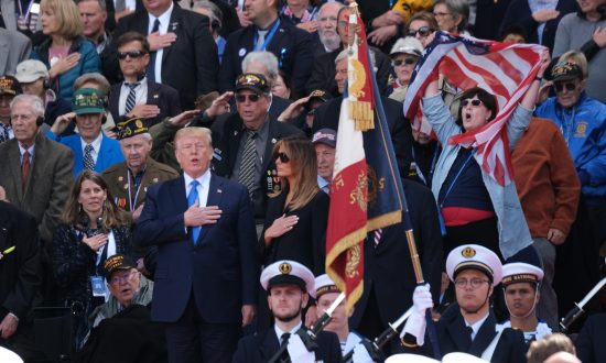 Melania Trump High-Fives 95-Year-Old Veteran Who Received a Legion of Honor Medal During D-Day Ceremony