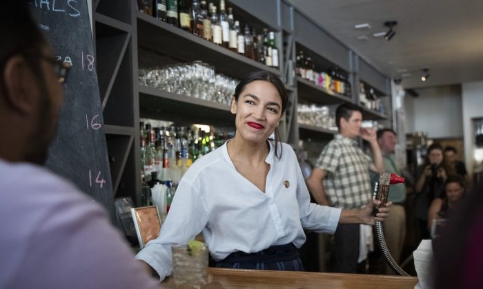 Rep. Alexandria Ocasio-Cortez works behind the bar at the Queensboro Restaurant in the Queens borough of New York City on May 31, 2019. (Drew Angerer/Getty Images)
