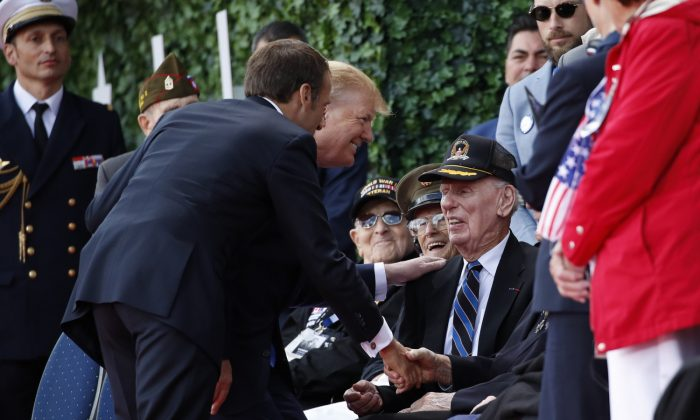 President Donald Trump and French President Emmanuel Macron greet veterans as they arrive to a ceremony to commemorate the 75th anniversary of D-Day at The Normandy American Cemetery in Colleville-sur-Mer, Normandy, France on June 6, 2019. (Alex Brandon/AP Photo)
