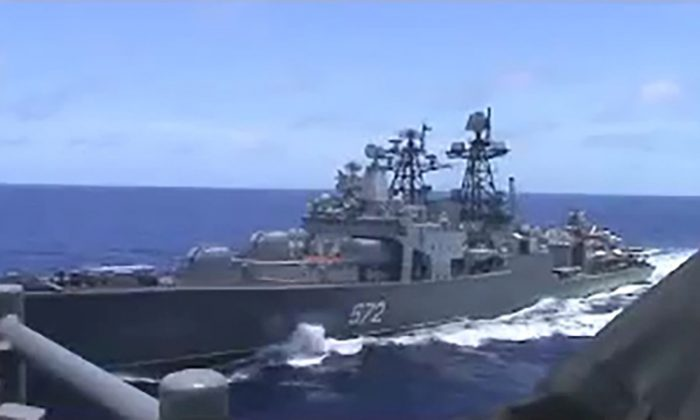 A screen grab from video shows the Russian naval destroyer Udaloy making what the U.S. Navy describes as an unsafe maneuver against the Ticonderoga-class guided-missile cruiser USS Chancellorsville in the Philippine Sea on June 7, 2019. (U.S. Navy/Handout via Reuters)