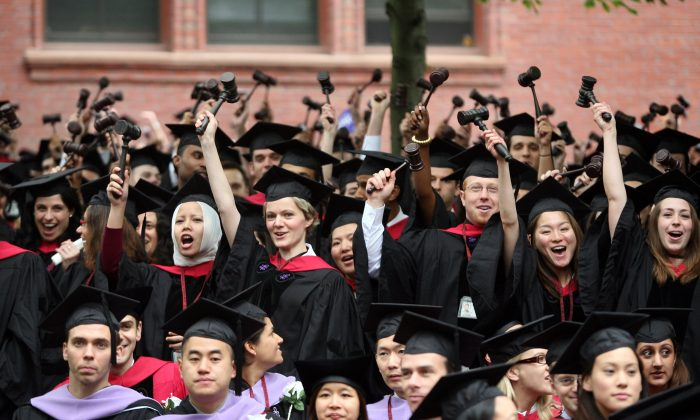Graduating Harvard University Law School students stand and wave gavels in celebration at commencement ceremonies in Cambridge, Mass. on June 5, 2008. (Robert Spencer/Getty Images)