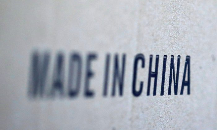 Words 'Made in China' are pictured on a box of products imported from China at a wholesale shop in Paris, France on Aug. 10, 2018. (Regis Duvignau/Reuters)