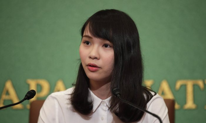 Prominent Hong Kong activist Agnes Chow speaks during a news conference at Japan National Press Club in Tokyo on June 10, 2019. Chow said many in the territory were angered by the government's bulldozing of a legislative proposal that would allow extradition of criminal suspects to mainland China, seeking international support for the resistance movement. (Jae C. Hong/AP)