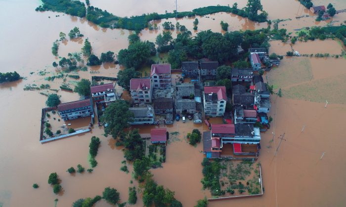Residential houses and cars are seen submerged in floodwaters following heavy rainfall in Taihe County, Jian, Jiangxi Province, China on June 10, 2019.  (Reuters)