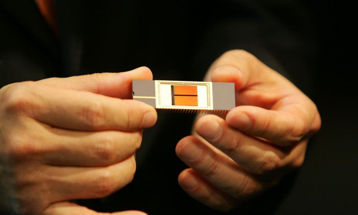 A 32-Gigabite NAND memory chip is displayed at a news conference at the Shilla hotel in Seoul, South Korea, on September 11, 2006. (Chung Sung-Jun/Getty Images)