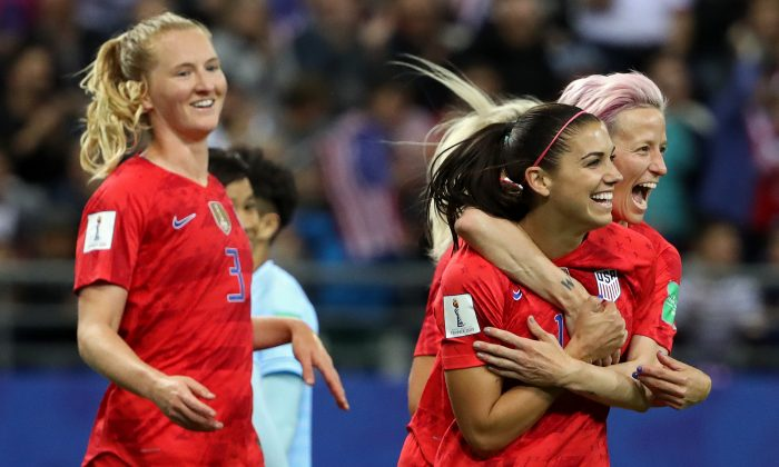 Alex Morgan of the USA celebrates with teammates after scoring her team's fifth goal during the 2019 FIFA Women's World Cup France group F match between USA and Thailand at Stade Auguste Delaune in Reims, France on June 11, 2019. (Robert Cianflone/Getty Images)
