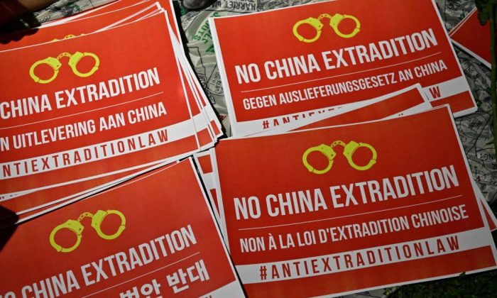 Posters that read No China Extradition are displayed as people gather outside the government headquarters in Hong Kong late on June 11, 2019. (Anthony Wallace/AFP/Getty Images)