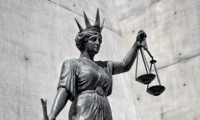 A statue of Themis, the Greek God of Justice stands outside the Supreme Court in Brisbane, Australia. (Dave Hunt/AAP Image)