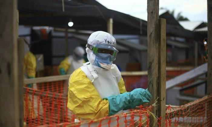 Ebola health worker at a treatment center in Beni, Eastern Congo. On April, 16, 2019. (AP Photo/Al-hadji Kudra Maliro)