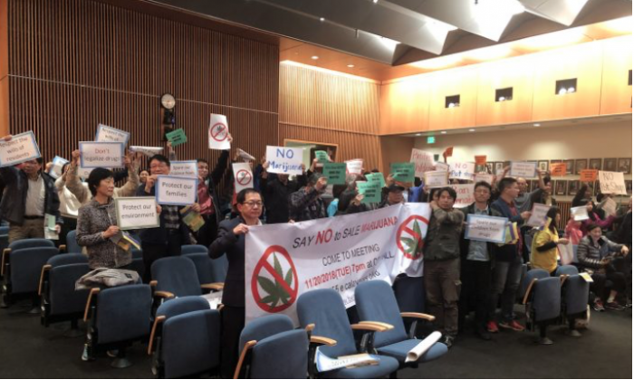 Protesters showed banners against cannabis industry during the city council meeting at Milpitas City Hall in Milpitas, Calif. on Nov. 20, 2018. (Nathan Su/The Epoch Times)