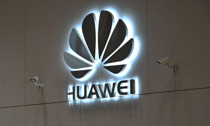 A company logo is displayed at a reception area at the Huawei headquarters in Shenzhen, Guangdong Province, China on May 29, 2019. (Hector Retamal/AFP/Getty Images)