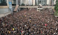 'Sea of Black' Hong Kong Protesters Demand Leader Step Down
