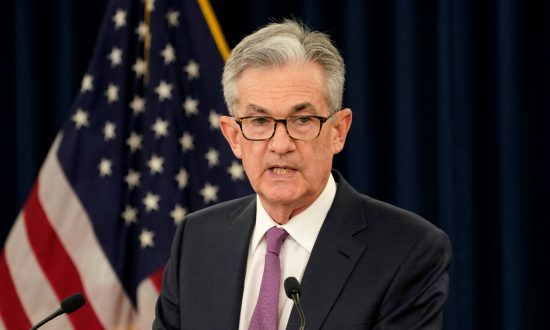 Fed Leaves Interest Rate Unchanged, but Signals Future Cuts
