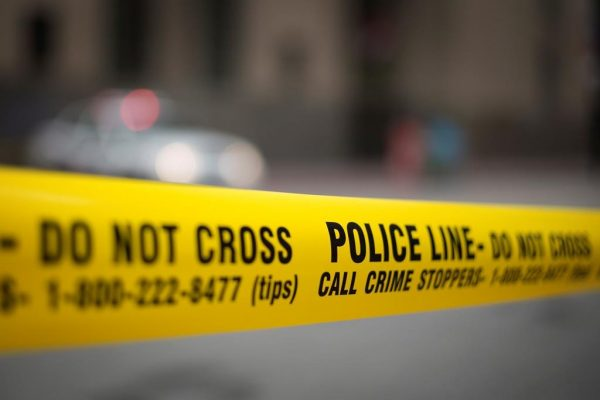 Police tape is shown in Toronto, May 2, 2017. Statistics Canada says the country's crime rate ticked up again in 2018, for a fourth year in a row, though it was still lower than it was a decade ago. (Graeme Roy/The Canadian Press)