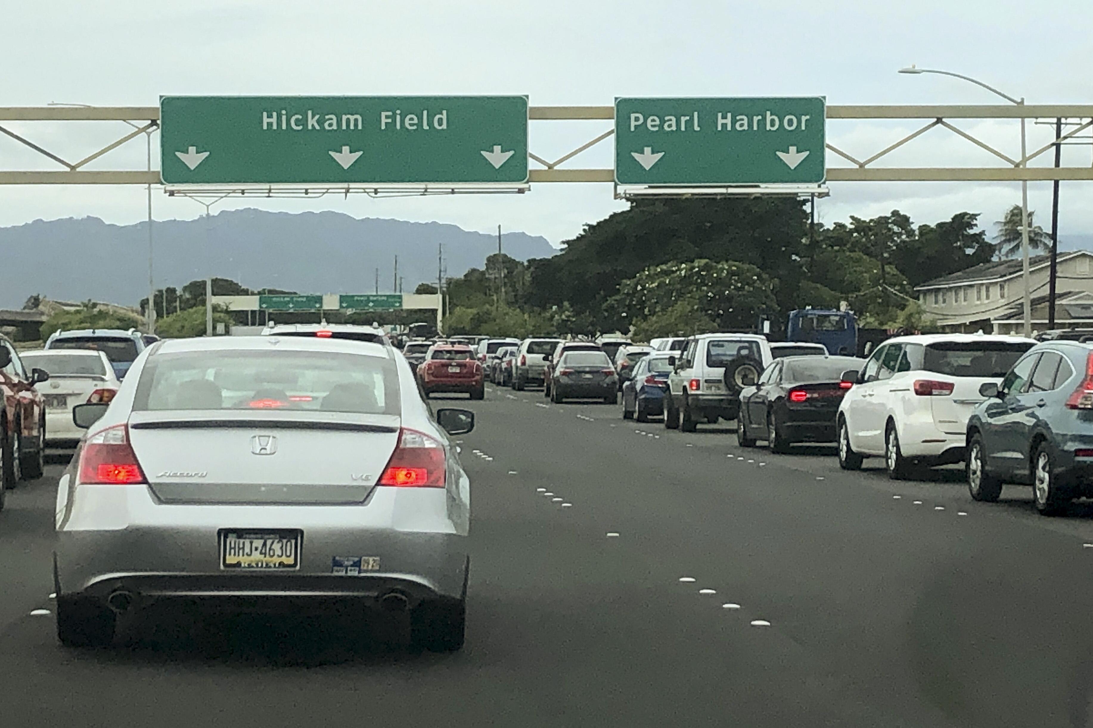 Traffic backs up at the main gates