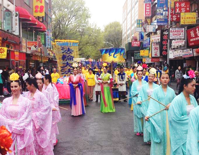 Falun Gong performers depicting heavenly maidens prepare to move out for the Flushing parade. (Leo Timm/Epoch Times)