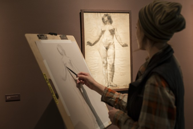 """A student copies a drawing displayed in the """"Drawn to Life"""" exhibit at the Florence Academy of Art-U.S. Branch in Jersey City, N. J., on Feb. 28, 2017. (Samira Bouaou/Epoch Times)"""