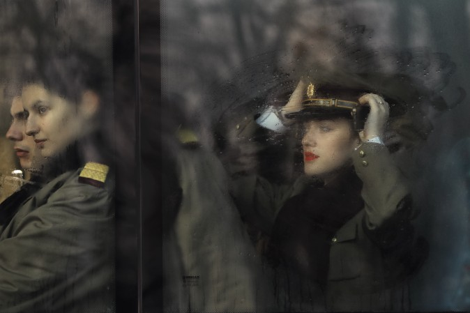 Romanian military doctors and medical students sit on a bus before the National Day parade in Bucharest, Romania, on Dec. 1. Military planes and helicopters flew over the Romanian capital Thursday as thousands turned out to celebrate the national day, marking the date when the country reunified with Transylvania in 1918. (AP Photo/Vadim Ghirda)