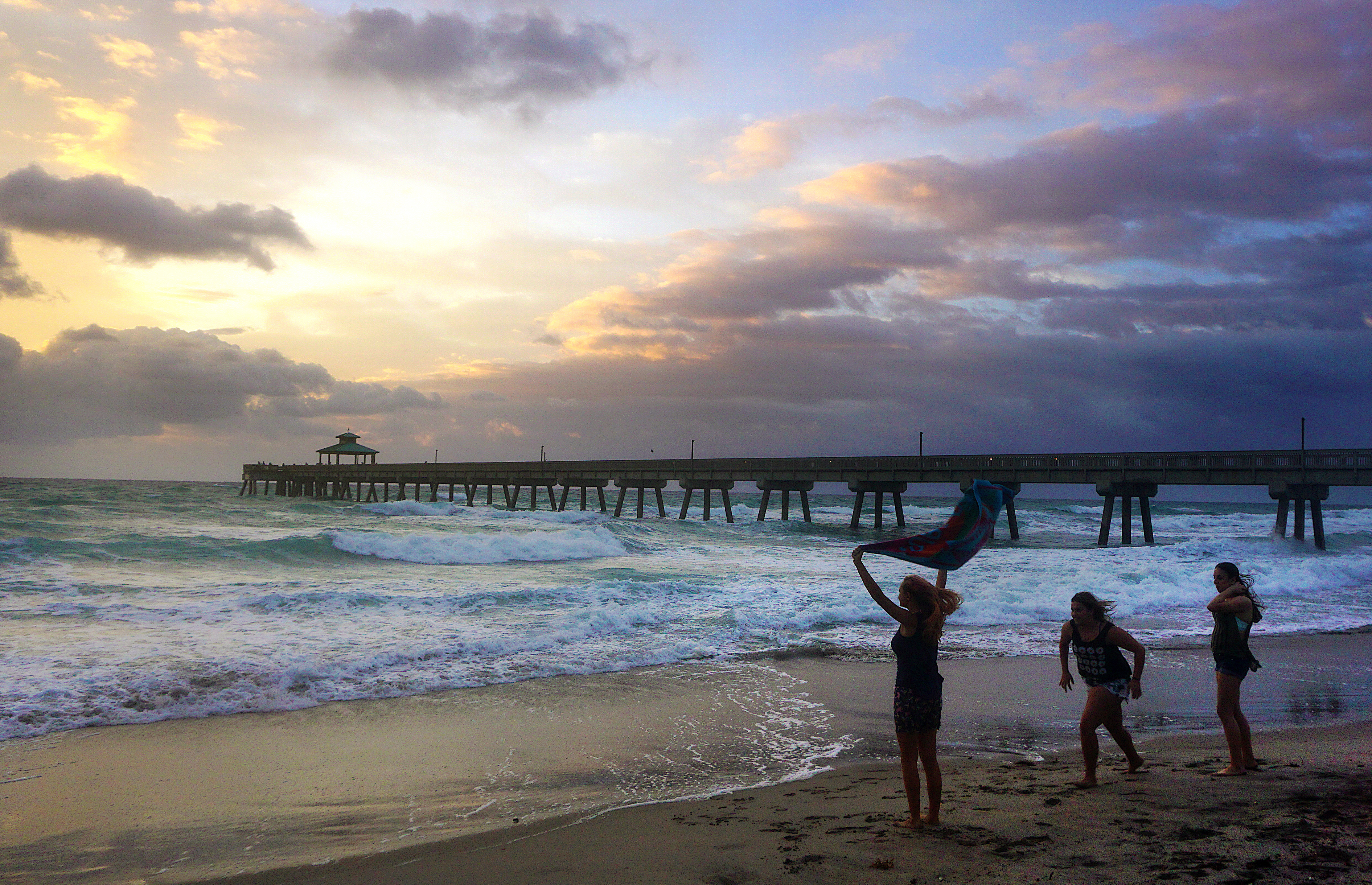 People view a sunrise on a windy day at Deerfield Beach, Fla., on April 18. (Rolando Otero/South Florida Sun-Sentinel via AP)