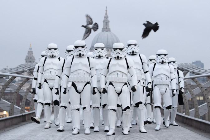 """People dressed as Stormtroopers are on the Millennium Bridge to promote the latest release of the first """"Star Wars,"""" spin off series, """"Rogue One: A Star Wars Story,"""" in London on Dec. 15. (Leon Neal/Getty Images)"""